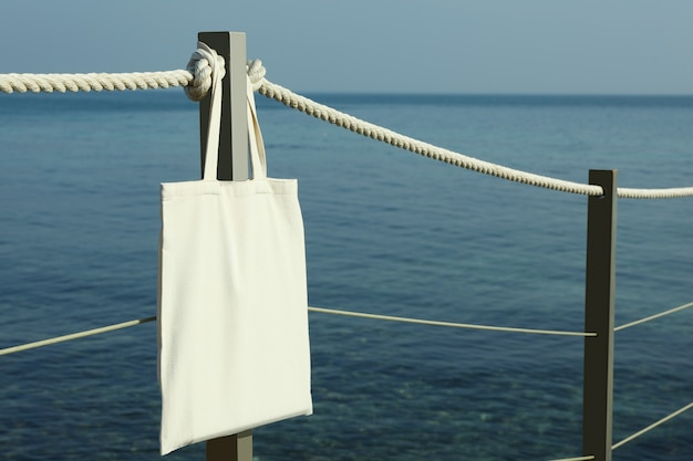 Blank eco bag on pier on the seashore