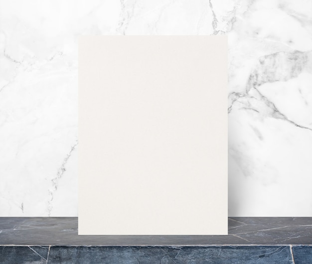 Blank eco paper notepad on black stone table top at white marble stone wall,template mock up for adding your design.