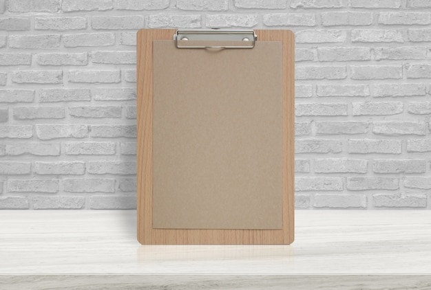 Blank eco paper notepad on stone table top at old brick wall