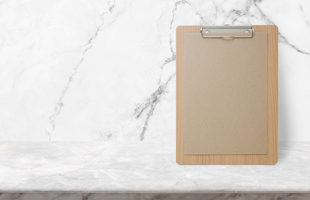 Blank eco paper notepad on stone table top at white marble wall