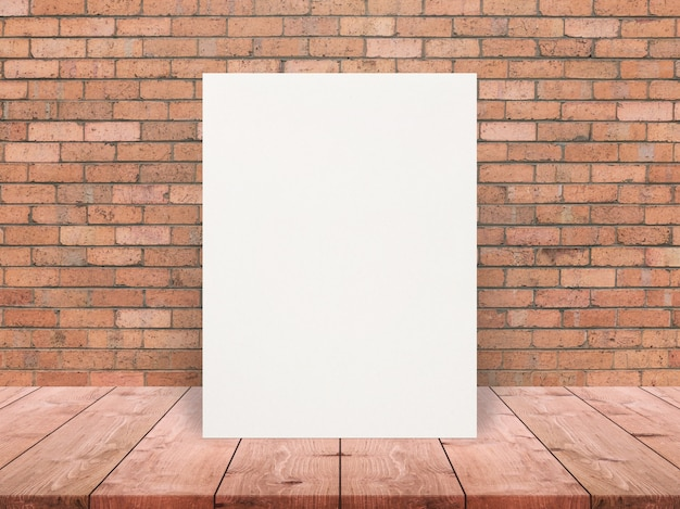 Blank eco textured paper poster on wood table top at old brick wall