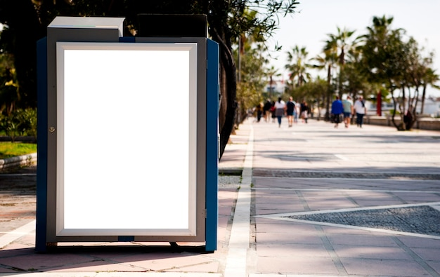 Blank electronic advertising billboard at a bus stop