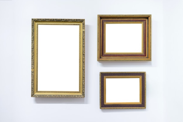 Blank empty frames hanging on museum wall, art gallery, museum exhibition