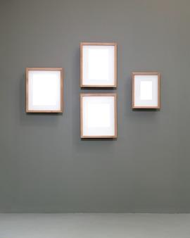 白い背景の上の空白の空の金色のフレーム。アートギャラリー、美術館展