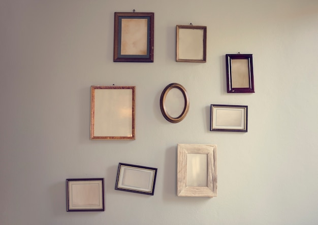 Blank empty photo frames hanging on the wall