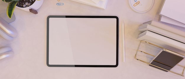 Blank empty screen laptop mock up on working space decorated with office supplies in modern design