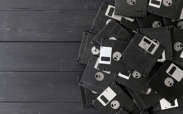 Blank floppy disks on wood background