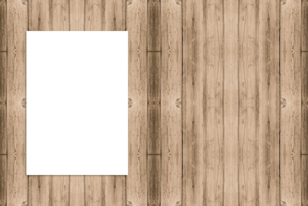 Blank folded paper poster hanging on wooden wall,template mock up for adding your design.