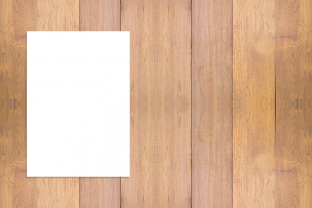 Blank folded paper poster hanging on wooden wall