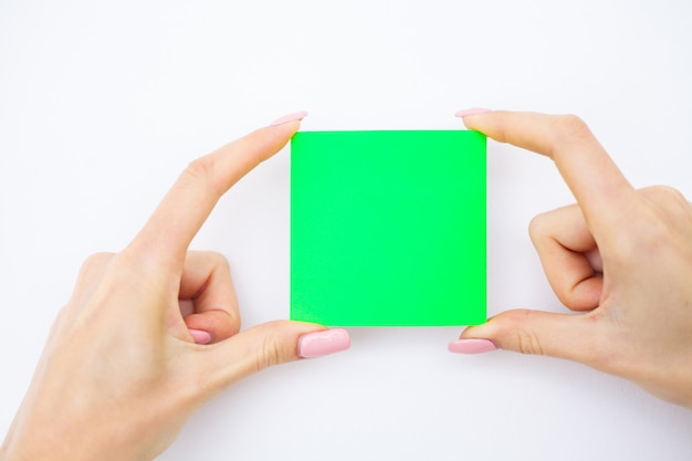 Blank folder with green paper. hand that holding folder and pan handle on white background