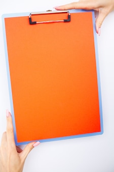 Blank folder with range paper, hand that holding folder and handle on white