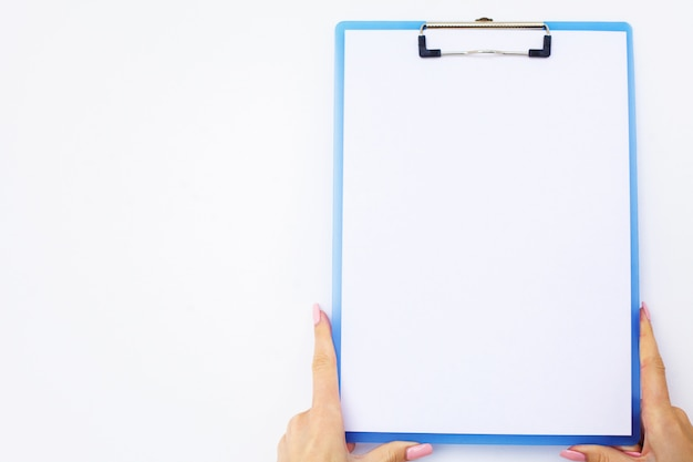 Blank folder with white paper. hand that holding folder and handle on white background. copyspace.