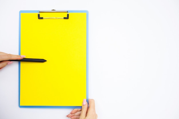 Blank folder with yellow paper.