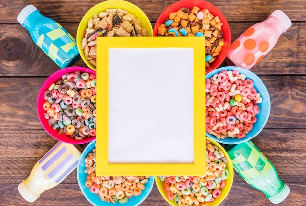 Blank frame on bright bowls of cereals and bottles