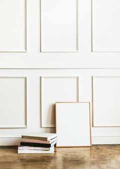 Blank frame by a white wall