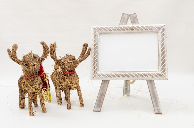Blank frame in easel for christmas menu, or invitation for christmas with decoration
