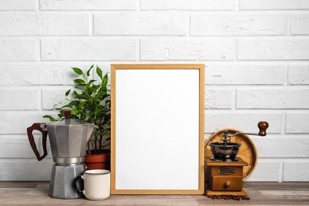 Blank frame next to flower pot and grinder