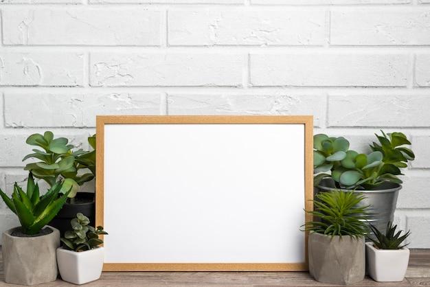 Blank frame next to flower pots