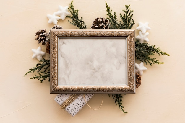 Blank frame on green branches