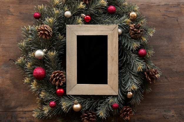 Blank frame in green christmas wreath