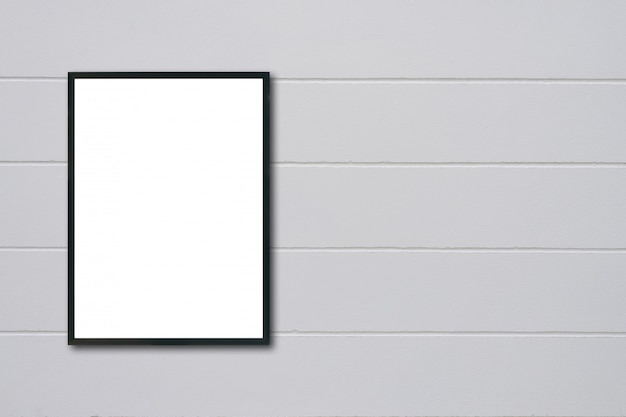 Blank frame hanging on wall.