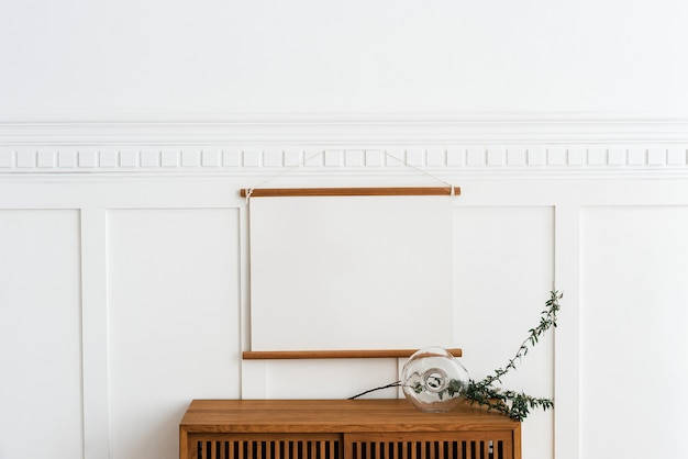 Blank frame hanging above a wooden cabinet