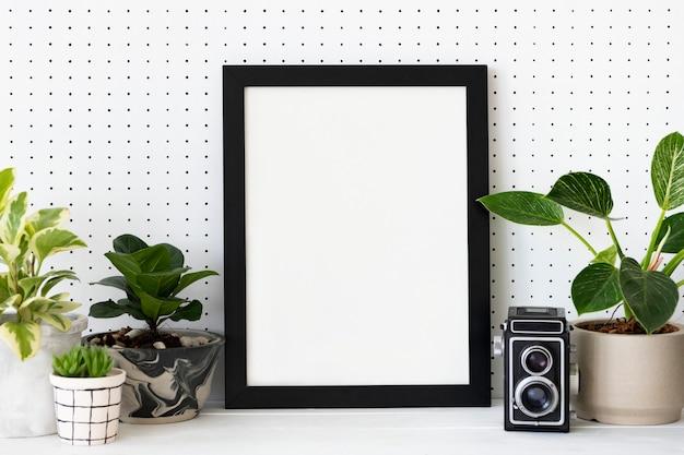 植物の棚の家の装飾のアイデアの空白のフレーム