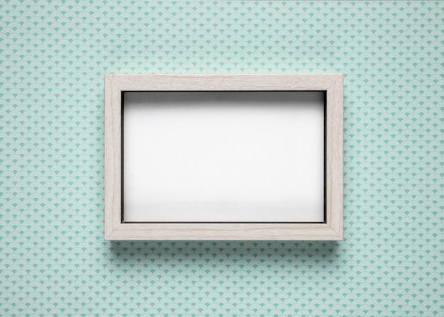 Blank frame on teal background