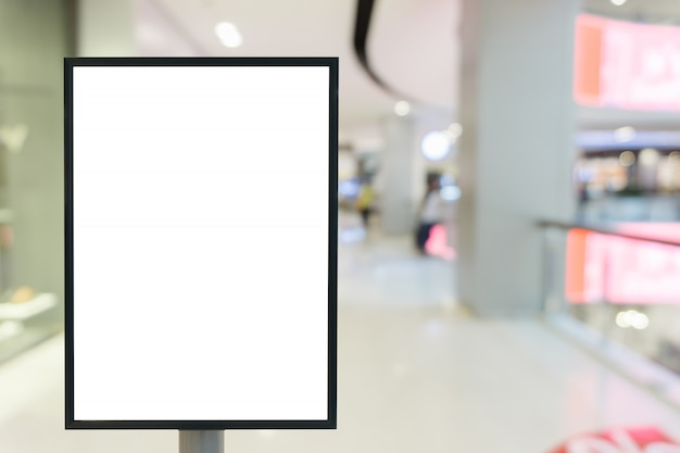 Blank frame of vertical poster billboard sign for your text in shopping mall.