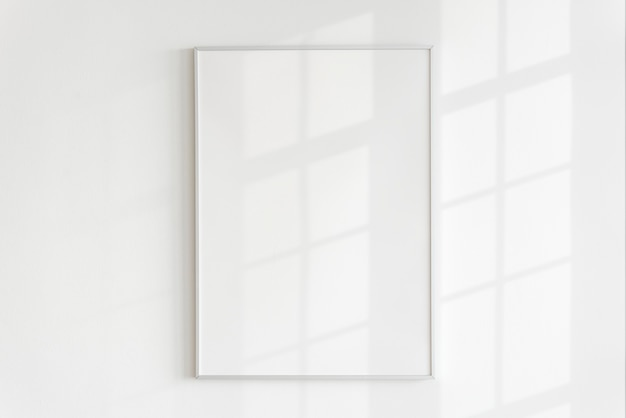 Blank frame on a wall with natural light