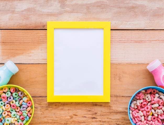 Blank frame with bowls of cereals and milk