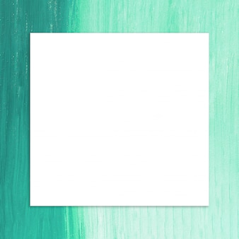 Blank frame with brush of green paint background