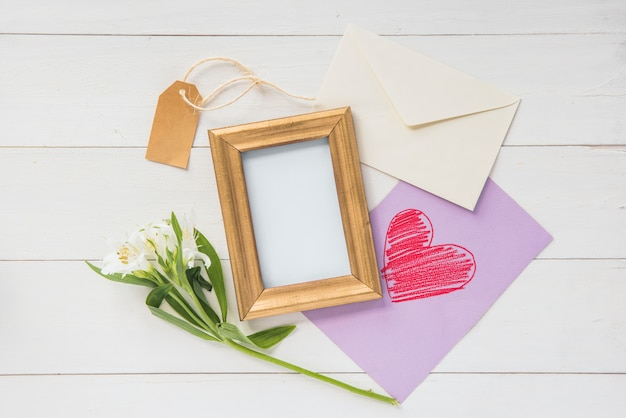 Blank frame with flowers and heart drawing