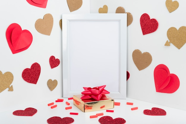 Blank frame with paper hearts