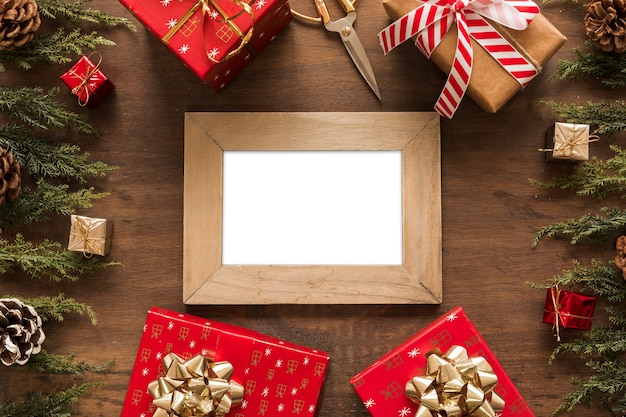 Blank frame with small gift boxes