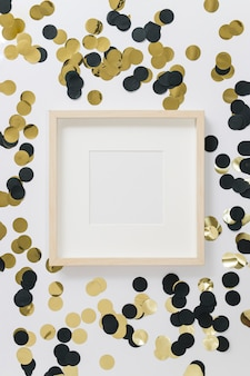 Blank frame with spangles on table