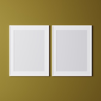 Blank frames on yellow wall, mock up, vertical white frames for poster on the wall, photo frame isolated on the wall