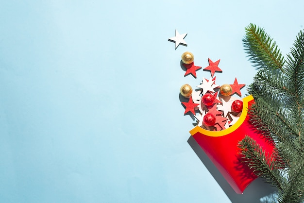 Blank french fries box with colored wooden new year's stars