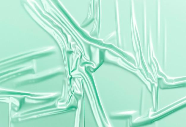 空白の緑色のしわくちゃのプラスチックホイルラップオーバーレイモックアップ空の使い捨てセロハンパッケージモックアップ