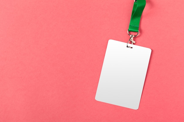 Blank  greeting card or tag  on pink  surface