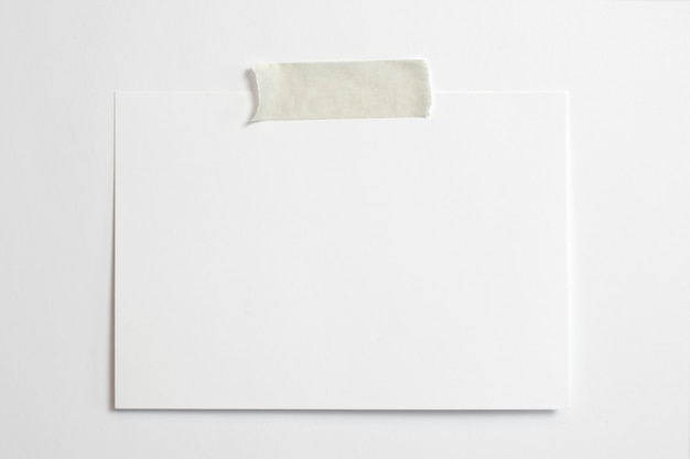 Blank horizontal photo frame 10 x 15 size with soft shadows  and scotch tape isolated on white paper background
