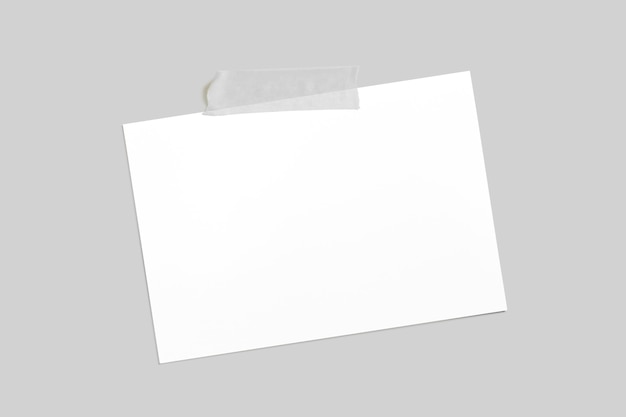 Blank horizontal photo frame with scotch tape isolated on grey paper background