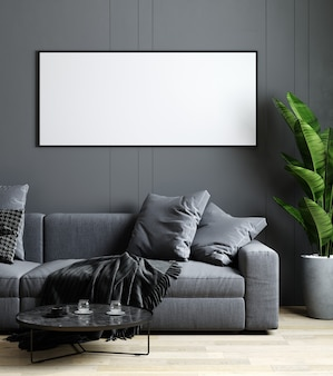 灰色の壁、ソファ、コーヒーテーブルとモダンなインテリアの背景でモックアップ空白の水平額縁