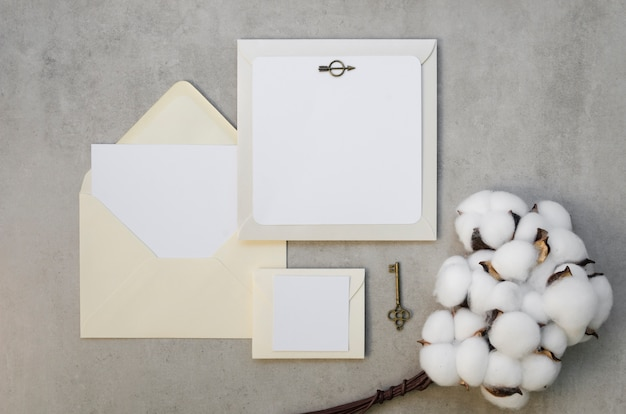 Blank invitation card with cotton flowers