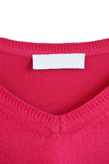 Blank label on a red sweater