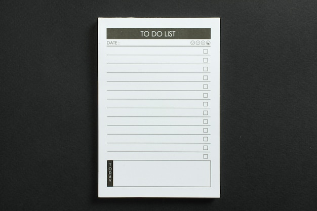 Blank to do list pocket planner with checklist for checkmark on black textured background