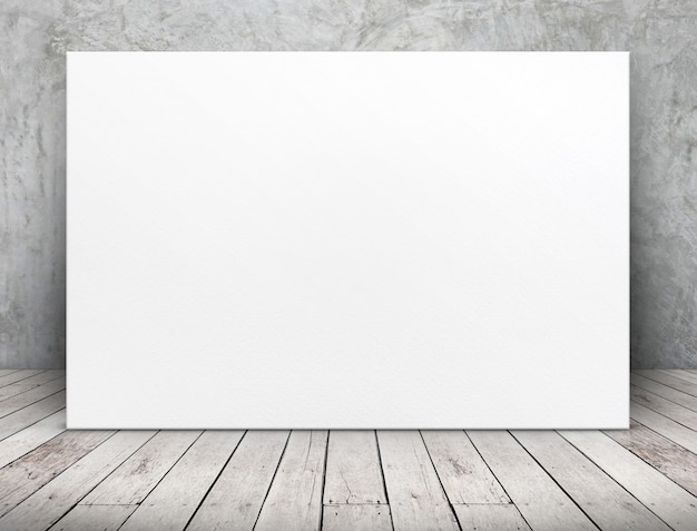 Blank long white paper poster leaning at concrete wall on wooden plank floor in room
