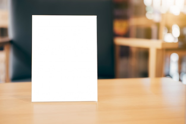 Blank menu frame on table in coffee shop stand for your text of display