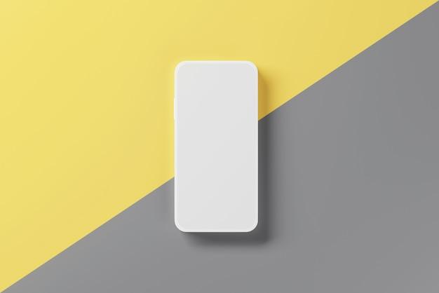 黄色と灰色の表面に空白のモバイルスマートフォン。