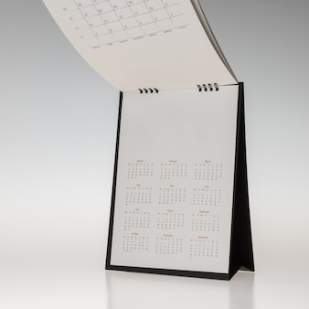 Blank mockup for design black cover paper spiral table calendar isolated on white background